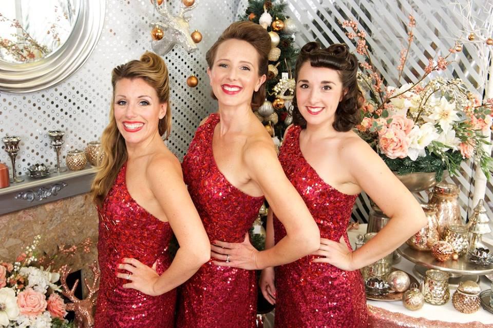 UK Band called Santa Babies Three ladies dressed in Red