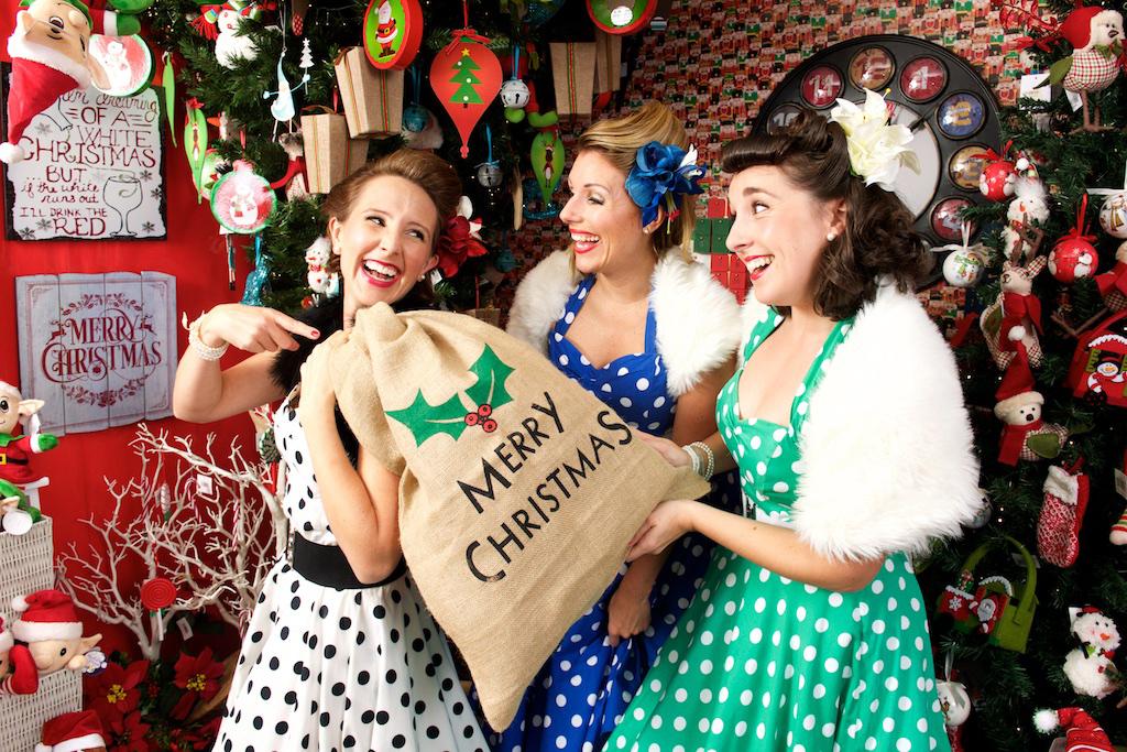 UK Band called Santa Babies three ladies with gifts