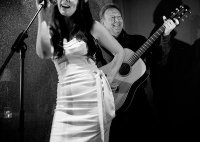 Lady Singing with Guitarist Black and White