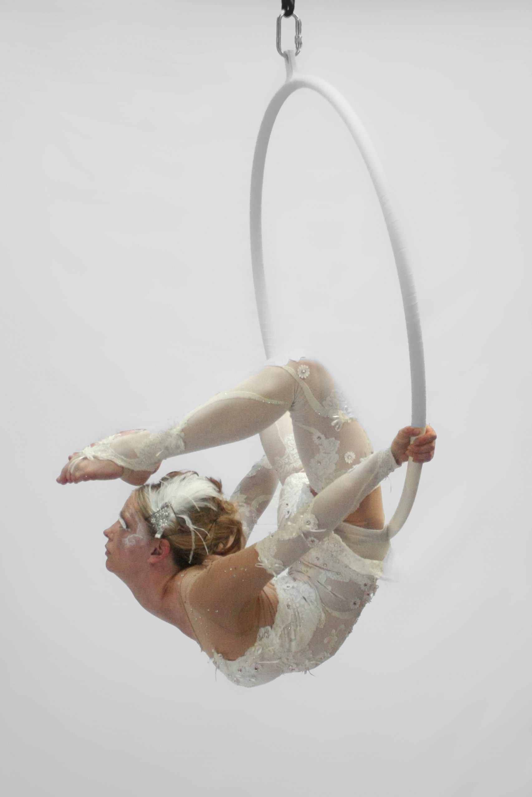 JF Aerialist and contorionist in white in a hoop