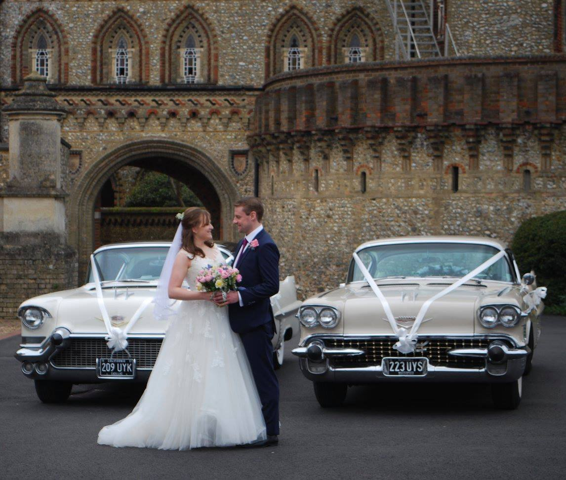 vintage wedding cars with bride and groom posing infront
