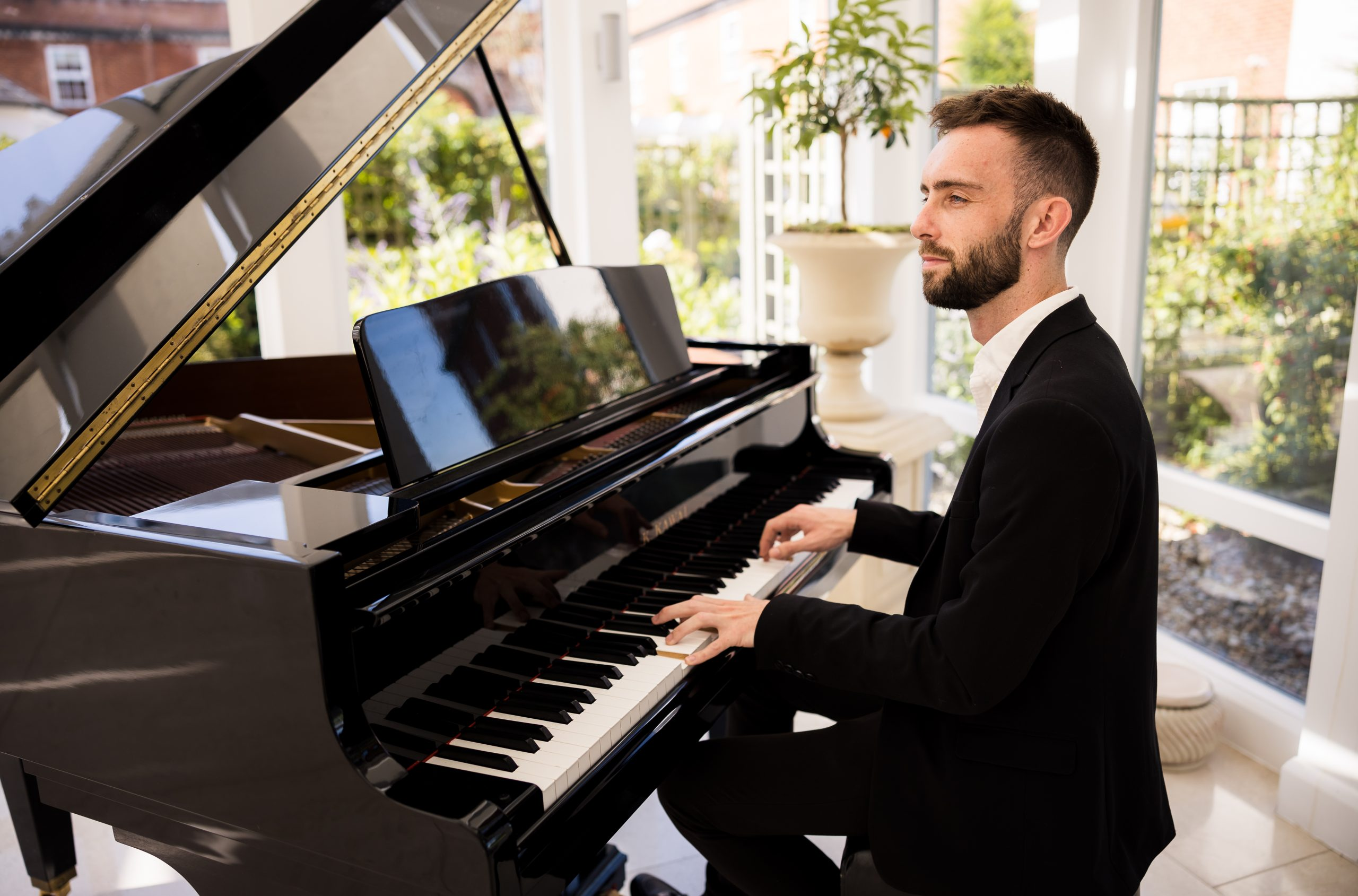 Solo pianist at grand piano for events weddings parties and functions