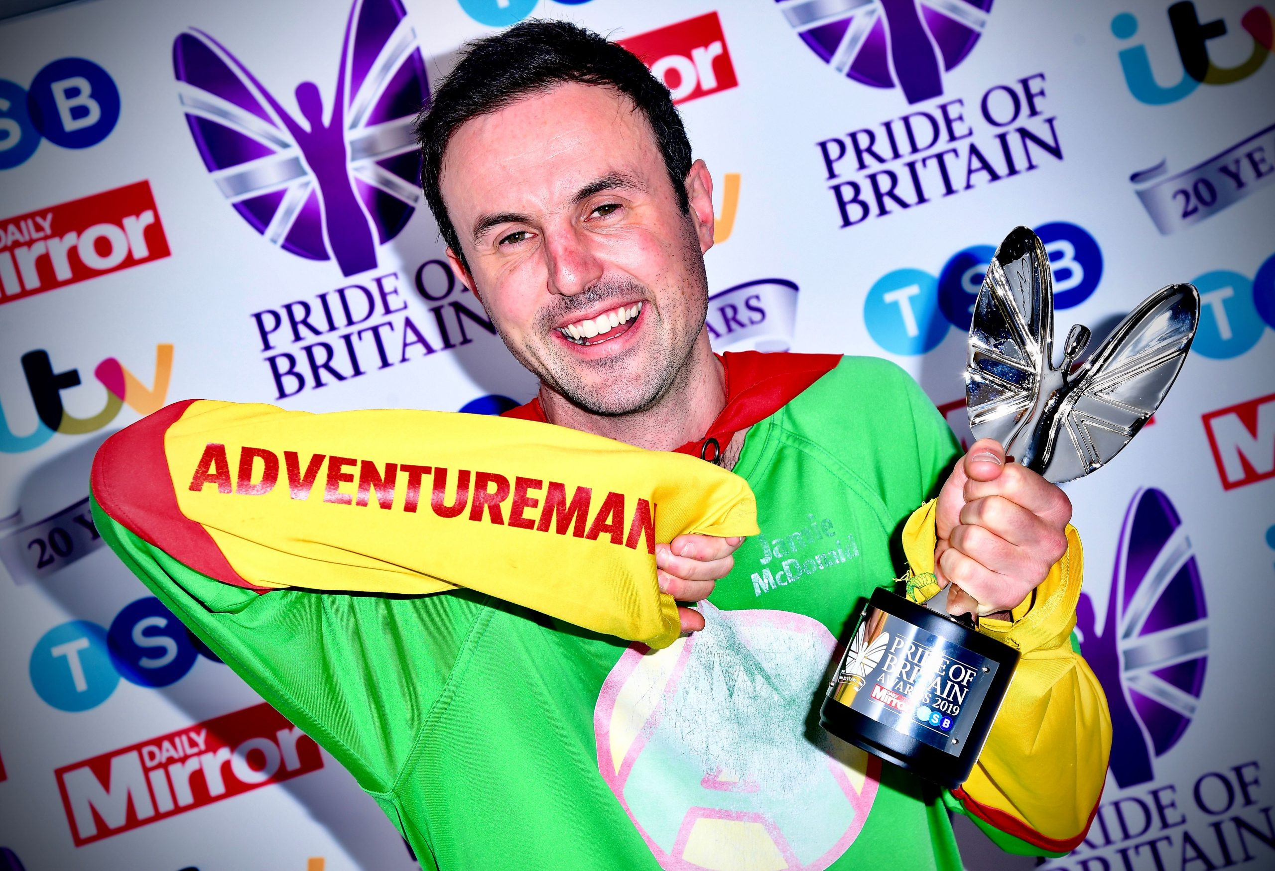 Motivational Speaker, Jamie MacDonald, known as Adventureman holding a Pride of Britain award