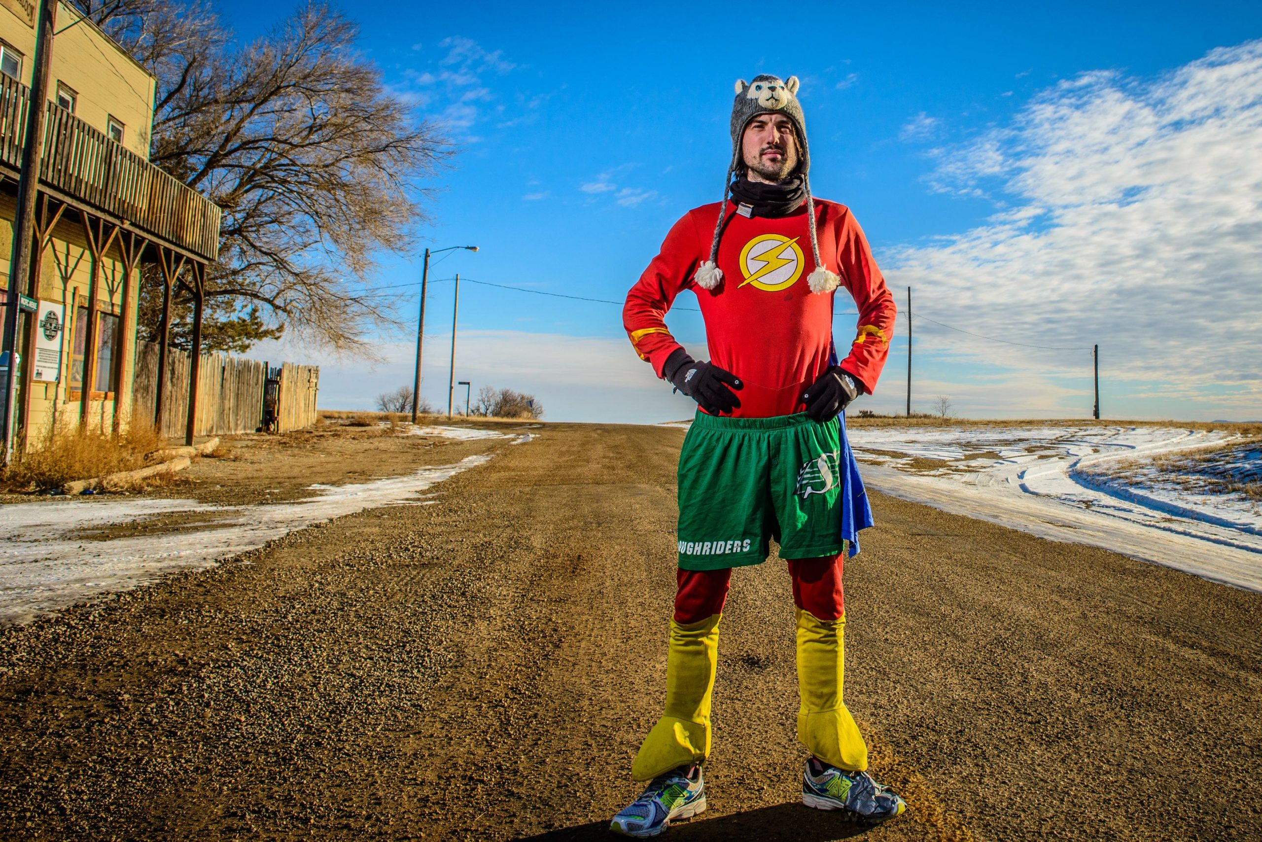 Motivational Speaker, Jamie MacDonald, known as Adventureman standing in the middle of an empty road